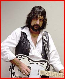 August Manley as Waylon Jennings